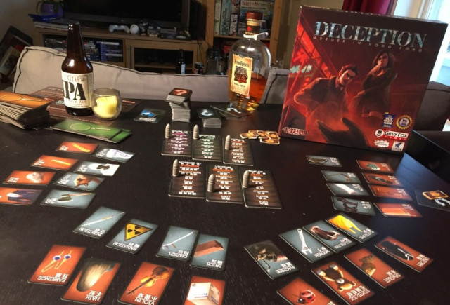 Picture of the gritty cards and bullet-themed markers of Deception